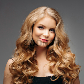 Stunning natural beauty with blonde wavy hair.