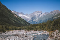 Close up view mountains and river scenes in national park Dombai, Caucasus