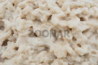 Closeup of foam on a beach