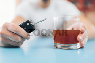 Drunk man at the bar intends to drive back home