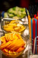 Orange, lemon and lime slices on the wedding table