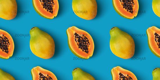 Papaya fruit seamless pattern on blue color background