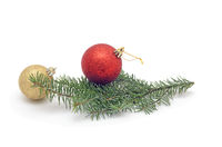 one red ball on Christmas tree branch and more golden ball isolated on white background.