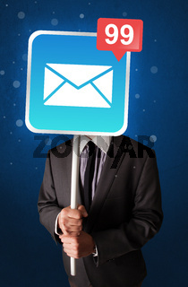 Businessman holding mail sign