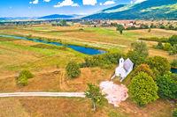 Stone church by Gacka river aerial view