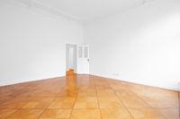 empty room with open door and wooden floor   - new flat old building