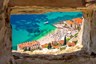 Banje beach in Dubrovnik aerial view through stone window