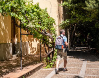 Photographer walks through the gardens in Salamanca Spain