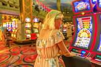 Woman plays slot machines