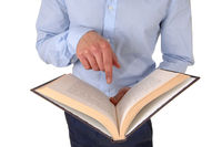 Close up of a man reading in a book