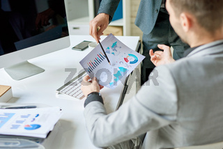 Business Men Discussing Statistics Report