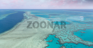 Amazing aerial overhead view of Queensland Coral Reef at sunset, Australia