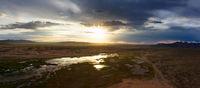 Sand dunes Bayan Gobi and lake at sunset