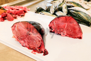 Parts of chopped tuna fish on the counter