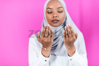 African Muslim woman makes traditional prayer to God