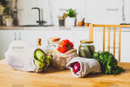 Zero waste shopping concept - groceries in textile bags and glass jars