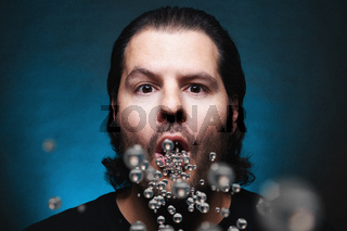 Man with open mouth exhaling or inhaling plastic particles. Environmental pollution and drug ingestion concept.