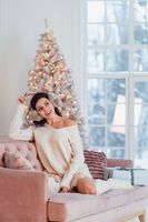 Young lady white caucasian woman in white dress. Christmas concept