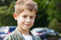 Blond boy in car park