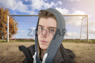 portrait of a young man in front of a soccer goal