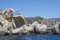 Coastal rocks village in distance sea Mallorca
