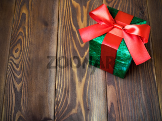 Gift box on the wooden board