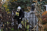 Skeletons and pumpkins decorated ordinary houses for Halloween in New England