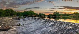Beautiful view of the dam on the river at sunset