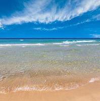Sea surf on beach.