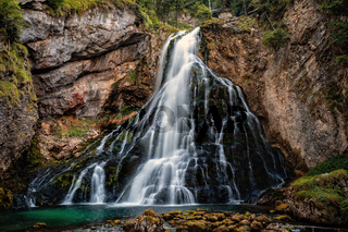 Beautiful view of famous Gollinger Wasserfall with mossy rocks and green trees, Golling, Salzburger Land, Austria
