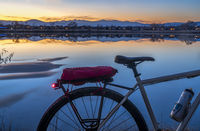 silhouette of a touring bike against sunset