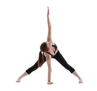 Yuong girl doing yoga isolated shot