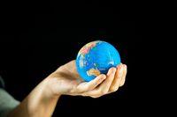 Hand holding earth globe