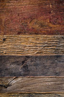 Aged wooden crannied planks background from above