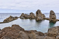 Natural lava rock pool and sea in Porto Moniz in Madeira