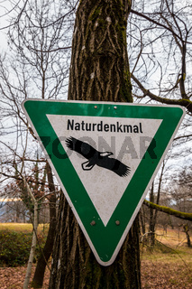 Environmental traffic sign in the middle of the forest