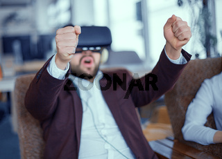 Adult bearded man with virtual reality vr glasses