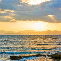 Sunset with island on the horizon
