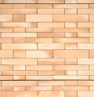 full frame image of a wall made of large flat blocks of textured light brown york stone in different sized rows