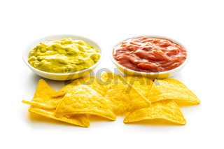 Corn nacho chips with avocado and tomato dip.