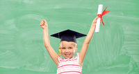 happy little girl in mortarboard with diploma