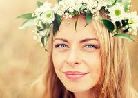 happy woman in wreath of flowers