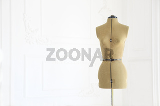 Mannequin with cloth in the white room