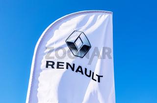 Dealership flag of Renault against the blue sky