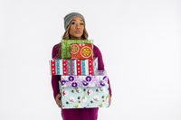 Beautiful African American Model Posing With Christmas Gifts In A Studio Environment Against A White Background