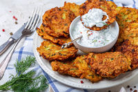 Delicious zucchini fritters with yogurt sauce.