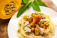 Spaghetti with roast butternut squash, meat and sage. Original italian Pasta