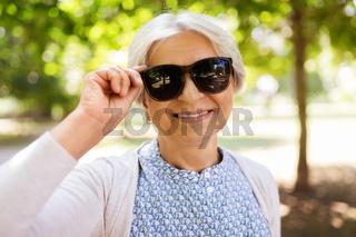 portrait of happy senior woman at summer park