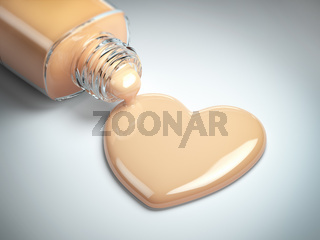 Liquid makeup foundation cream in form of the heart symbol and glass bottle.