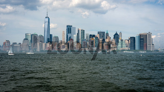 Skyline and modern office buildings of Midtown Manhattan viewed from across the Hudson River. - Image